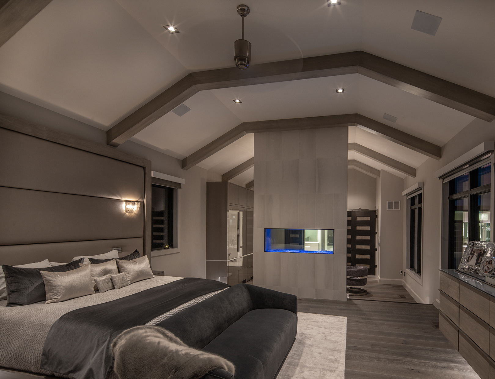 Large bedroom with several windows looking outside
