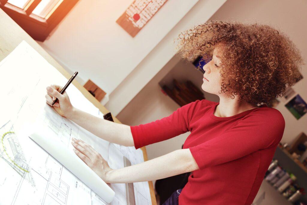 Aspiring residential architect works on a blueprint